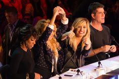 Kelly Rowland, Paulina Rubio, Demi Lovato, and Simon Cowell at the judges table.