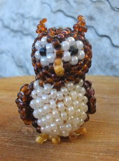 3D Horned Owl   The first design in a new series of cute peyote pets.  This owl is good for: - sitting on your desk - he is good company. - wearing as a pendant - with a loop on top, or as earrings (if made with tiny seed beads).  Experience with sculptural peyote would be helpful, but is not essential.