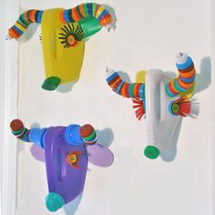 Wall trophies. Made by South African artisans, using recycled materials (laundry soap bottles, milk bottle lids etc.)