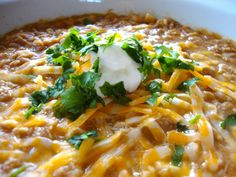 White chicken chili: chicken, beans, corn, garlic, taco seasoning, green chilies, cream of chicken soup, chicken broth. Toppings: sour cream, lime juice, cilantro, cheese tortilla chips