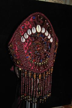 Ọmọ Esú  Ọ̀dára: ASÍNDE : SOLD: Finished Crown for Yansa/Oya. Textile on pap...