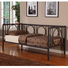 This circular tube metal day bed is finished in beautiful textured black color. This bed includes 7 metal slats to be used as a mattress platform.