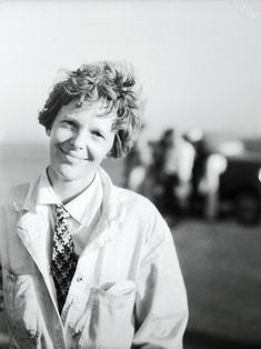 """July 4, 1933  """"Amelia Earhart, first lady of aviation, is shown immediately after she landed her Lockheed Vega plane at the Los Angeles Municipal Airport, July 2, after completing a transcontinental flight from the East. Miss Earhart failed to qualify, due to delays encountered on her flight. She said it was the most hazardous trip she had ever made. The crowd gave her a tremendous ovation as she brought her ship to the ground, during the second day's events of the National Air Races."""""""