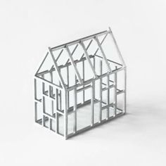 A cute little metallic structure for your desk or bookshelf. www.mooreaseal.com