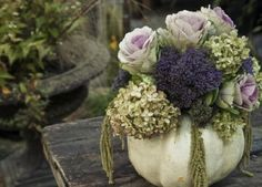 Love this for Thanksgiving. I love these flowers and also the color scheme will work well with the burlap and white table settings.