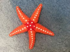 This beautifully textured starfish was needle felted by Susan Nolte of Portland, Oregon for her brand new little grand-niece! She felted him using Merino Cross Batting Core Wool, New Zealand Tange...