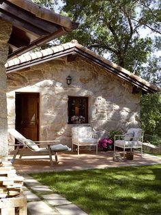 Casa de campo en piedra y carpintería en madera