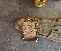 Check out this item in my Etsy shop https://www.etsy.com/listing/519677320/gold-madonnavirgin-maryreligious