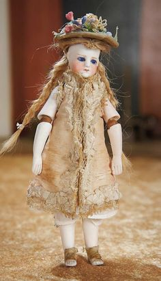 The Empress and the Child - Antique Dolls: 36 All-Bisque Mignonette with Jointed Elbows and BTE Marking