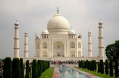 The Taj Mahal in Agra, India designed by Ustad Ahmad Lahauri in Agra, India, It's made out of marble and took 22 years and 20 000 workers to complete. Words cannot do the Taj Mahal justice, its incredible detail simply has to be seen to be appreciated. Taj Mahal Image, Le Taj Mahal, Best Vacation Destinations, Best Vacations, Eiffel Tower Photography, Surreal Photos, Great Inventions, India Tour, Islamic Architecture