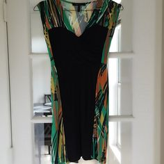 BCBG PRINTED DRESS BCBG PAINT PRINT DRESS. CAN BE BELTED OR WORN BY ITSELF. SUPER COMFORTABLE MATERIAL AND VERY STRETCHY. ONLY WORN ONCE! BCBGMaxAzria Dresses Midi