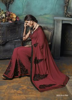 Indian Red color saree based on Georgette material with beautiful Black color embroidered work