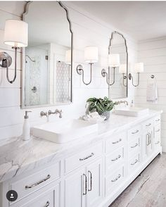 Happy St Patrick's Day!! I don't have any green for you but I do have this stunning bathroom. I can't stop staring at it. Those mirrors, sconces, the details in the shower and of course the #shiplap. Design by @tracylynnstudio