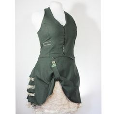 """Military Green Ruffle Bustle Skirt and Corset Laced Halter Set FRONT   This was such a fun outfit to design and put together. I added a little bit of neo-victorian fashion, steampunk style, lolita cuteness and just a dash of military flavor to create this two piece set. The top and skirt exterior are made of a lightweight green suiting and lined with a creamy """"antique white"""" silky satin. This out fit has adjustable sizing in both the skirt and the halter top, but I recommend that it fits…"""