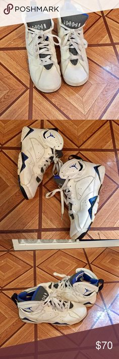 AIR JORDAN 7 DEFINING MOMENTS AIR JORDAN DEFINING MOMENTS. WHITE/ VARSITY ROYAL BLUS/ BLACK. SIZE 7 in men or a 9 in women  2009 release. They are pretty dirty and have been sitting in my closet since 2009 but can easily be cleaned. Air Jordan Shoes Sneakers