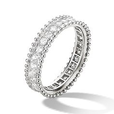 Van Cleef & Arpels Estelle diamond ring  A platinum and diamond wedding band from the Bridal fine jewellery collection by Van Cleef & Arpels. A ring of brilliant-cut white diamonds are set within the Van Cleef & Arpels signature perlée band. Named after co-founder Estelle Arpels, this diamond band has been created to sit perfectly next to the Estelle engagement ring. Worn as a wedding set, or alone, this is a delicate, feminine diamond ring from Van Cleef & Arpels.