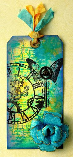 The Stamp Attic: Blues and blooms; I made one similar to this.  One of the first tags I made; love the colors...