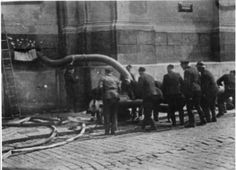 """Photo: OSOBNÍ ARCHIV EDUARDA STEHLÍKA. The Germans called the Prague fire  brigade to their assistance and they  drove water and teargas into the crypt through a street window. Source: """"Assassination"""" by Michal Burian et al."""