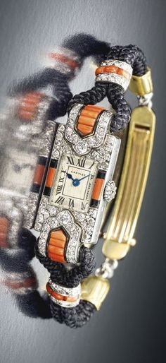 Cartier A LADY'S FINE AND RARE PLATINUM, CORAL, ENAMEL AND DIAMOND-SET RECTANGULAR WRISTWATCH CIRCA 1925