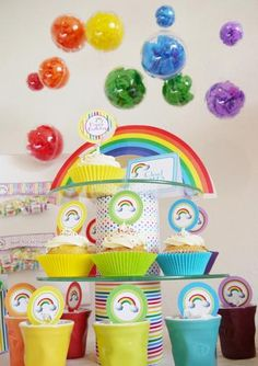 Can't imagine Brody wanting a rainbow birthday party....BUT, I love the hanging clear ornaments filled with something party related!