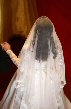 Kate Middleton - Royal Wedding A lovely picture from the back. Her veil was so transparent, it looked like it was made of clouds or angel wings or something. What a gorgeous bride with a lovely gown and veil.