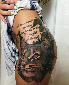 Amazing cat tattoo design on hip