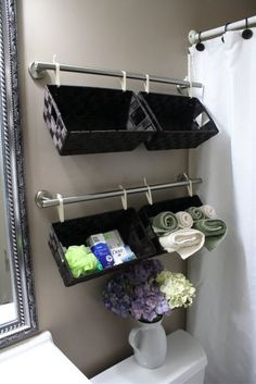 Basket for each child on the wall to keep all their stuff and easily get to it when its finally their turn in the bathroom