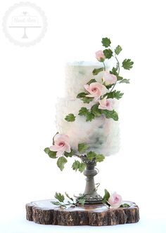 Enchanted garden wedding cake with two of the latest trends in cake design - edible wafer paper and rambling sugar flower arrangements.