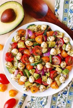 Avocado Salad with Tomatoes, Mozzarella, and Basil Pesto – healthy recipe packed with nutrients and lots of fresh ingredients!  Perfect Spring and Summer salad!   Small fresh Mozzarella cheese balls are delicious when combined with avocado in this easy salad that also features red and yellow cherry tomatoes, cucumbers, and red onions.  The dressing for this...Read More