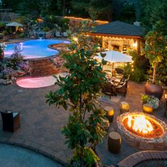 Poolscape, fire pit, gazebo with fireplace & living room - www.paradiserestored.com