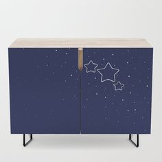 """A true statement maker. Our versatile mid-century modern inspired credenzas are great for use as TV stands, armoires, bar carts, office cabinets or the perfect complement to your bedroom set. The vibrant art printed on the doors will make your piece pop in any setting. Available in a warm, natural birch or a premium walnut finish. - 35.5"""" x 17.5"""" x 30"""" (H) including legs - Steel legs available in gold or black - Interior shelf is adjustabl..."""