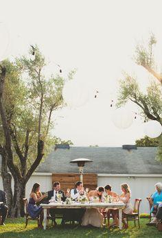 bridal party at vintage table between trees in outdoor reception - warm, sunny, Sonoma California vineyard wedding