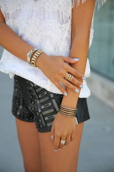 Leather shorts, lace blouse. Edgy romantic style