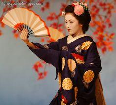 Geisha dancing with fan, Kotobuki-kai dance
