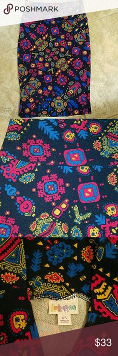 Lularoe Cassie Brand new, never worn. I took the tags off but decided it was too small for me. Magenta and navy Cassie skirt LuLaRoe Skirts Pencil