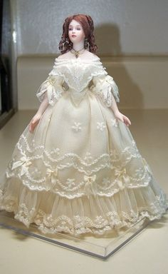 Lovely doll, sorry, I do not know who made/ dressed her :(