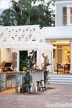 """REPURPOSED SHUTTERS –In Malcolm James Kutner's Key West house, the outdoor kitchen cabinets are made from old cypress shutters supplied by restorer Liz Devries. """"With outdoor living in general, it's about being friendly with nature and inviting it inside instead of trying to draw that heavy line in the sand that says, 'This is the outside and this is the inside,'"""" he says. Click through for more outdoor kitchens."""