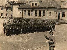 Bergen-Belsen; German soldiers on parade outside what appears to be WB 11  .Hohne Camp Collective