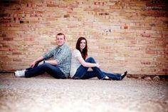 cute couple against the brick