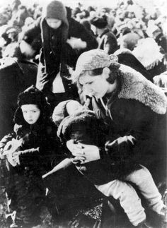 Lubny, Ukraine, A Jewish Woman Sitting With Her Children Before Their Execution  Photographs  Film and Photo Archive, Yad Vashem  All rights reserved