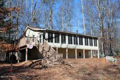 * NEW LISTING * Affordable fully furnished mountain getaway. Tucked away on a great Cul-de-sac lot this raised ranch home has plenty to offer. Enjoy the woods in the large sunroom or attached deck. Open floor plan living room with wood stove and vaulted ceilings. Room to grow in full daylight walk out basement. Many updates already done including kitchen and bath. Add al little TLC to finish it up your way. Access to skiing, pools, horses, boating, fishing and more!!