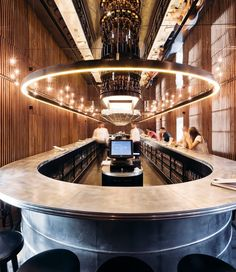 the flagship bar is dominated by a single 30-meter long counter, around which all guests gather to socialize and drink.