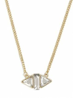A bit rock and roll but still classic custom necklace in yellow gold.  Loving the setting and the triangle shaped stones.