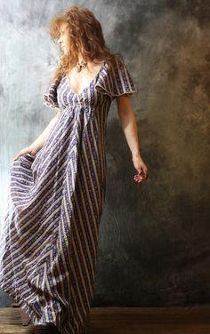 Vintage 1970s Sweetest Hippie Bohemian Maxi Dress Flutter Sleeves Calico Seersucker Full Flare Skirt. $68.00, via Etsy.