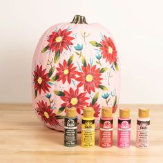 In October, we paint with pink! Try your hand at painting this fun pink floral pumpkin design in honor of Breast Cancer Awareness Month.