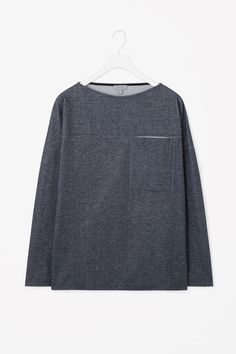 """Oversize denim jersey top $89 DETAILS This top is made from a soft denim jersey with a subtle brushed quality. An oversized fit, it has front pocket detail, long sleeves and stitched finishes.  95% Cotton / 5% Elastane / Length: 29"""" (Size M) / Product number 980590-76 / Imported"""