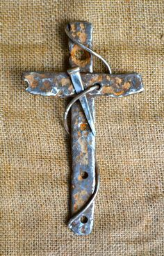 Scrap metal cross by Birmingham metal artist Catherine Partain.