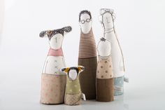 This Extended family and friends - grandparents, parents ,uncleand and children dressed in natural earth tones , stripes plaid and polka dots is part of TIMO-HANDMADE a small design line.    Sewn with an eye for detail and a touch for fabric.  Being hand-made, each and every item is one of a kind.    The Family Dolls series& members are different characters that can be put together as families. They are soft sculptures, and can stand on any flat surface.    This list includes Six Figures:  2…