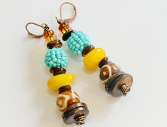 Fresh & Fun Tribal Dangle Earrings. These beautiful Afro-Centric Earrings are a Must Have this Spring! 3 inches long with antique copper wire. $25.00
