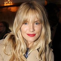 Wavy hair, fresh skin and a slick of bright lipstick. An easy Sunday lunch look. Sienna Miller